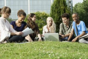 University students studying on grass outdoors, low angle view